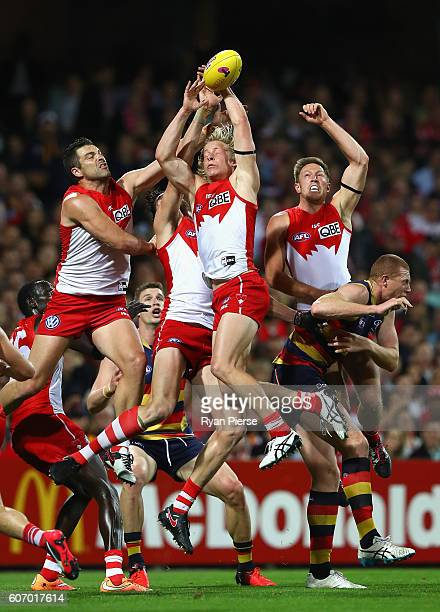 Heath Grundy Isaac Heeney and Jeremy Laidler of the Swans contest the ball during the First AFL Semi Final match between the Sydney Swans and the...