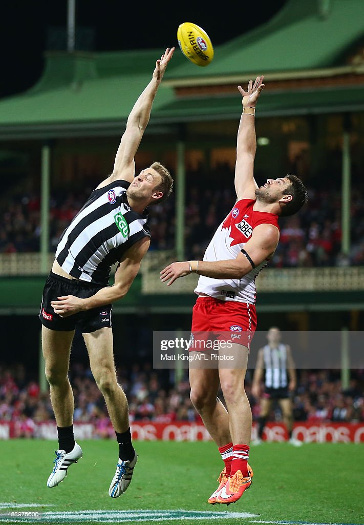Heath Grundy of the Swans competes for the ball against Ben Reid of the Magpies during the round 20 AFL match between the Sydney Swans and the...