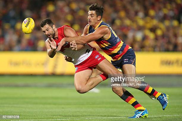 Heath Grundy of the Swans is tackled by Taylor Walker of the Crows during the 2016 AFL Round 04 match between the Adelaide Crows and the Sydney Swans...