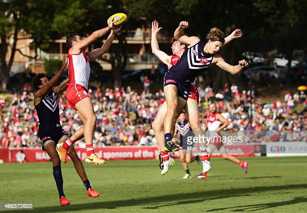 Heath Grundy of the Swans marks as Nat Fyfe of the Dockers competes during the NAB Challenge AFL match between the Sydney Swans and Fremantle Dockers...