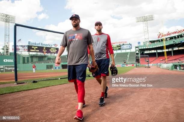 Heath Hembree and Matt Barnes of the Boston Red Sox walk into the dugout before a game against the Minnesota Twins on June 26 2017 at Fenway Park in...