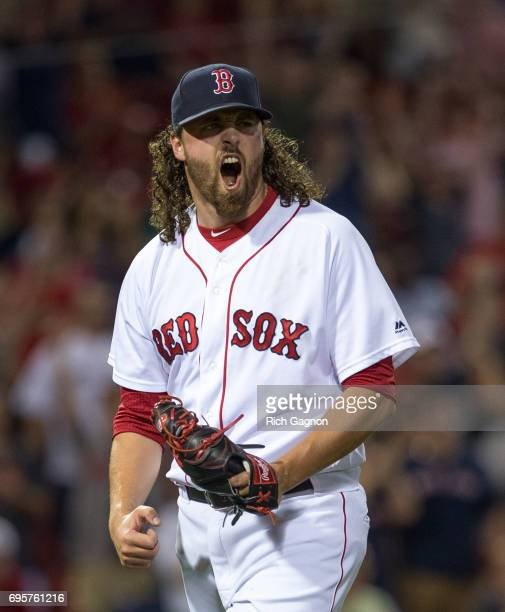 Heath Hembree of the Boston Red Sox celebrates after the final out of the tenth inning against the Philadelphia Phillies at Fenway Park on June 13...