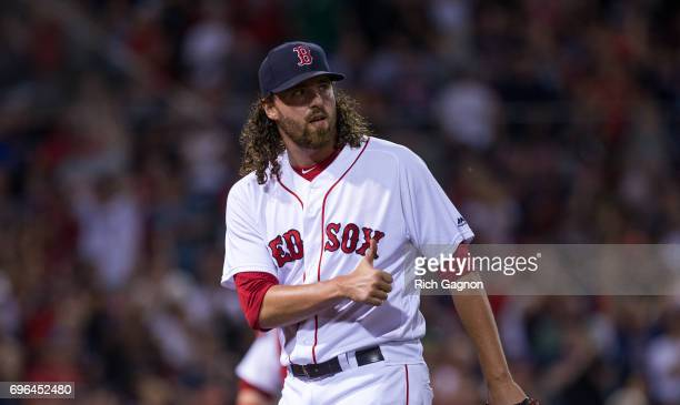 Heath Hembree of the Boston Red Sox celebrates after the final out of the 10th inning against the Philadelphia Phillies at Fenway Park on June 13...