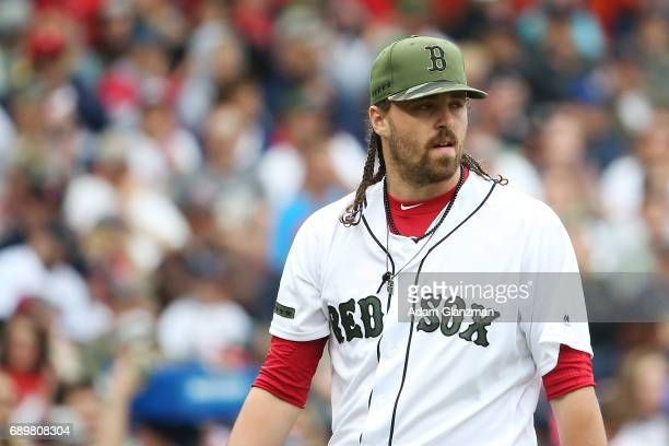 Heath Hembree of the Boston Red Sox looks on looks on in the seventh inning of a game against the Seattle Mariners at Fenway Park on May 28 2017 in...