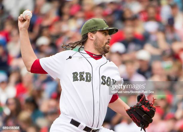 Heath Hembree of the Boston Red Sox pitches against the Seattle Mariners in the seventh inning at Fenway Park on May 28 2017 in Boston Massachusetts