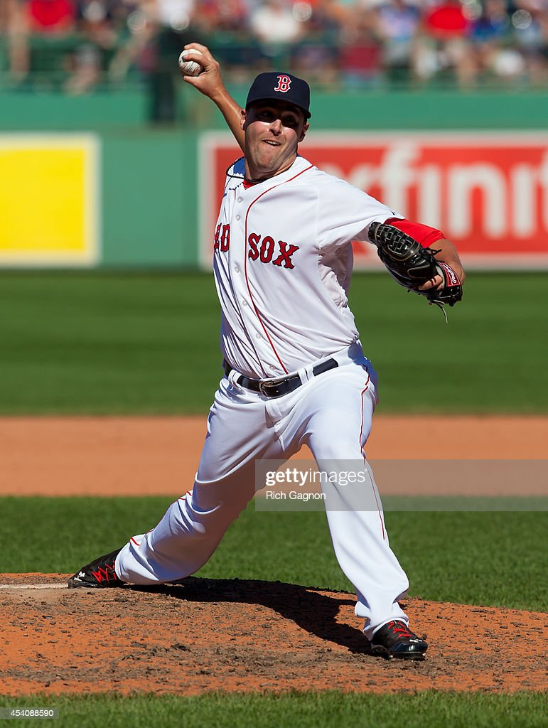 Heath Hembree #37 of the Boston Red Sox pitches against the Seattle Mariners during the sixth inning at Fenway Park on August 24, 2014 in Boston, Massachusetts.