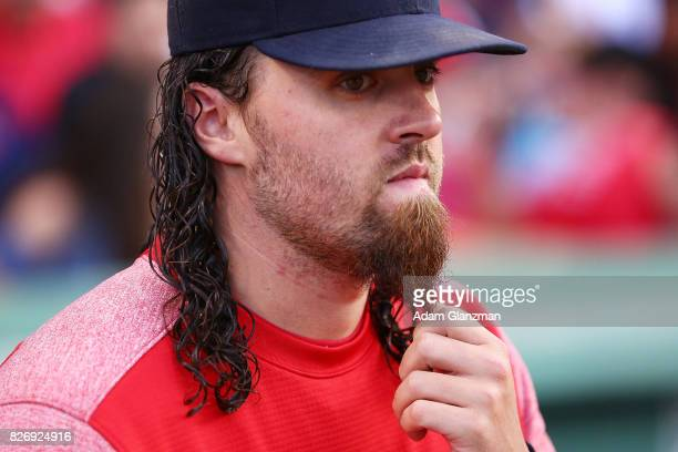 Heath Hembree of the Boston Red Sox plays with his beard before a game against the Chicago White Sox at Fenway Park on August 4 2017 in Boston...