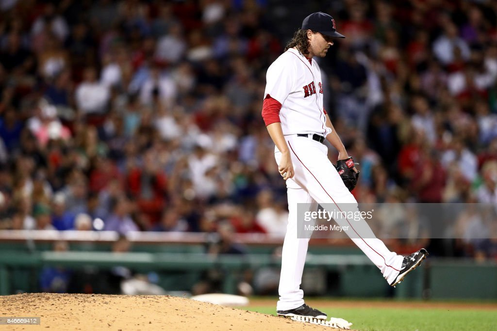 Heath Hembree #37 of the Boston Red Sox reacts after allowing a run during the sixth inning against the Oakland Athletics at Fenway Park on September 13, 2017 in Boston, Massachusetts.