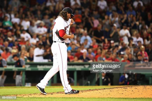 Heath Hembree of the Boston Red Sox reacts after giving up a grand slam to Justin Upton of the Detroit Tigers in the fifth inning of a game at Fenway...