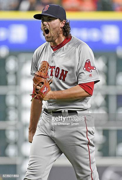 Heath Hembree of the Boston Red Sox reacts after striking out Marwin Gonzalez of the Houston Astros to win the game during the twelfth inning at...