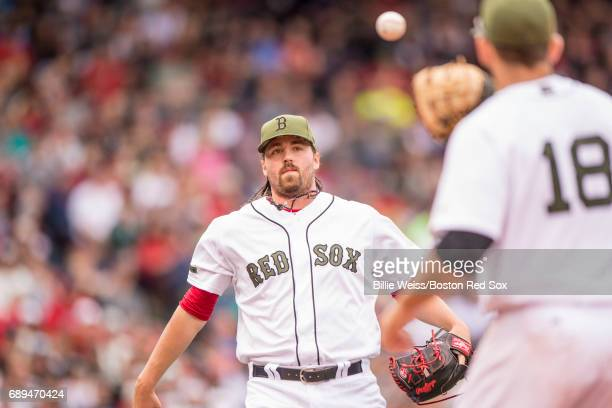 Heath Hembree of the Boston Red Sox tosses the ball to Mitch Moreland during the seventh inning of a game against the Seattle Mariners on May 28 2017...