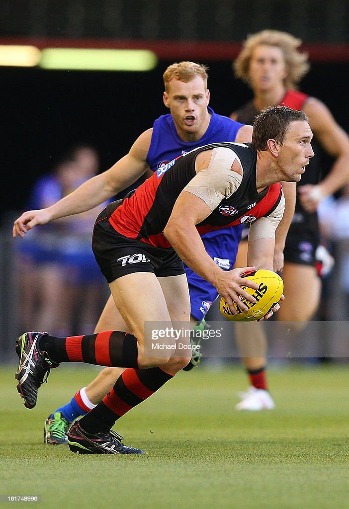 Heath Hocking of the Essendon Bombers runs with the ball during the round one AFL NAB Cup match between the Essendon Bombers and the Western Bulldogs at Etihad Stadium on February 15, 2013 in Melbourne, Australia.