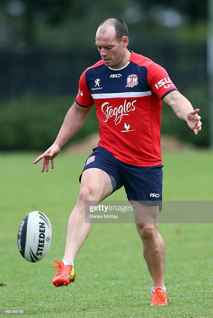 Heath L'Estrange kicks the ball during a Sydney Roosters NRL training session at Kippax Lake on April 7, 2014 in Sydney, Australia.