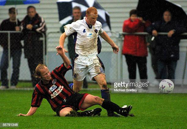Heath McCormack from University Mt Wellington is tackled by Peter Hendreicks from Metro FC in their clash in the Southern trust National league...