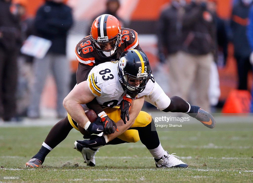 Heath Miller #83 of the Pittsburgh Steelers gets tackled by K'Waun Williams #36 of the Cleveland Browns during the second quarter at FirstEnergy Stadium on January 3, 2016 in Cleveland, Ohio.