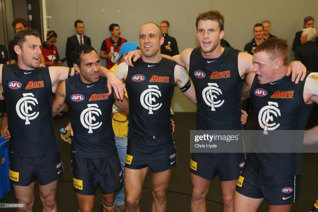 Heath Scotland, Eddie Betts, Chris Judd, Lachie Henderson and Mitch Robinson of the Blues sing the team song after winning the round 18 AFL match between the Gold Coast Suns and the Carlton Blues at Metricon Stadium on July 27, 2013 in Gold Coast, Australia.
