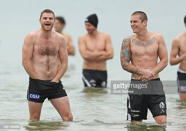 Heath Shaw and Dayne Beams of the Magpies wade in the water during a Collingwood Magpies AFL recovery session at St Kilda Sea Baths on May 7 2013 in...