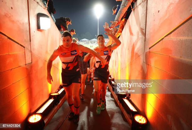 Heath Shaw and Dylan Shiel of the Giants lead their team from the ground after the round six AFL match between the Greater Western Sydney Giants and...
