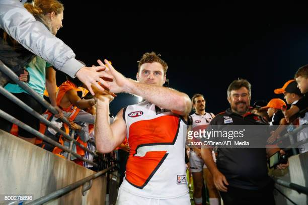 Heath Shaw of the Giants celebrates after his 250th game during the round 14 AFL match between the Brisbane Lions and the Greater Western Sydney...
