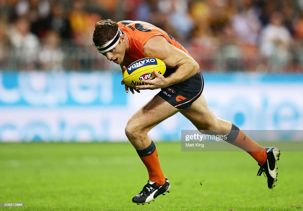 Heath Shaw of the Giants handles the ball during the round six AFL match between the Greater Western Sydney Giants and the Hawthorn Hawks at Spotless Stadium on April 30, 2016 in Sydney, Australia.