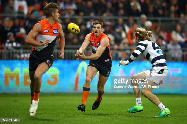 Heath Shaw of the Giants handpasses during the round 15 AFL match between the Greater Western Sydney Giants and the Geelong Cats at Spotless Stadium...
