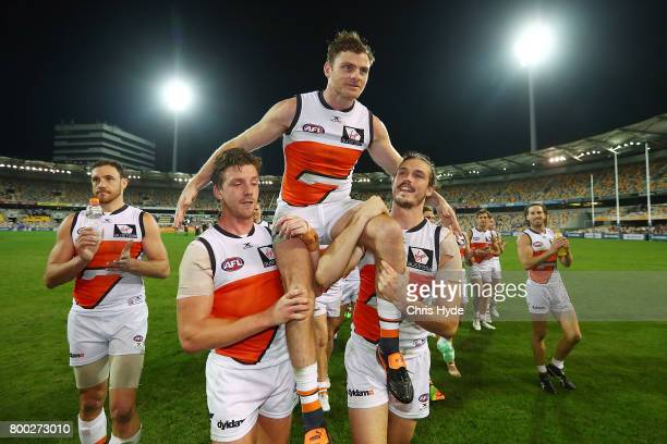 Heath Shaw of the Giants is chaired from the field after playing his 250th match during the round 14 AFL match between the Brisbane Lions and the...