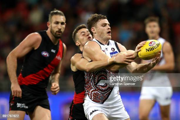 Heath Shaw of the Giants is tackled during the round 11 AFL match between the Greater Western Sydney Giants and the Essendon Bombers at Spotless...