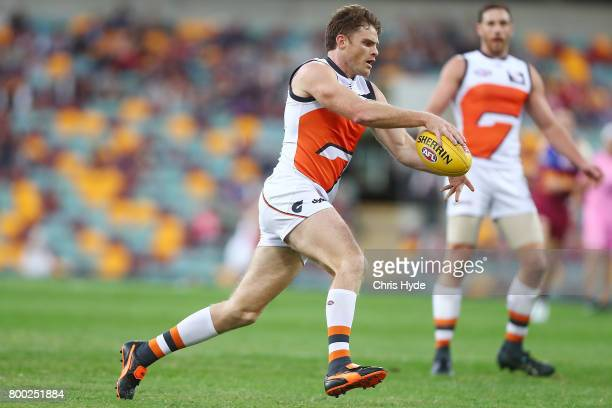 Heath Shaw of the Giants kicks during the round 14 AFL match between the Brisbane Lions and the Greater Western Sydney Giants at The Gabba on June 24...