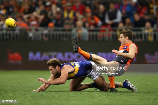 Heath Shaw of the Giants kicks over Mark Hutchings of the Eagles during the AFL First Semi Final match between the Greater Western Sydney Giants and...