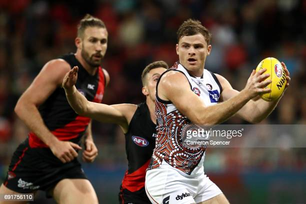 Heath Shaw of the Giants looks to pass during the round 11 AFL match between the Greater Western Sydney Giants and the Essendon Bombers at Spotless...