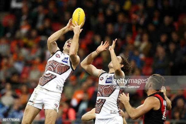 Heath Shaw of the Giants marks during the round 11 AFL match between the Greater Western Sydney Giants and the Essendon Bombers at Spotless Stadium...