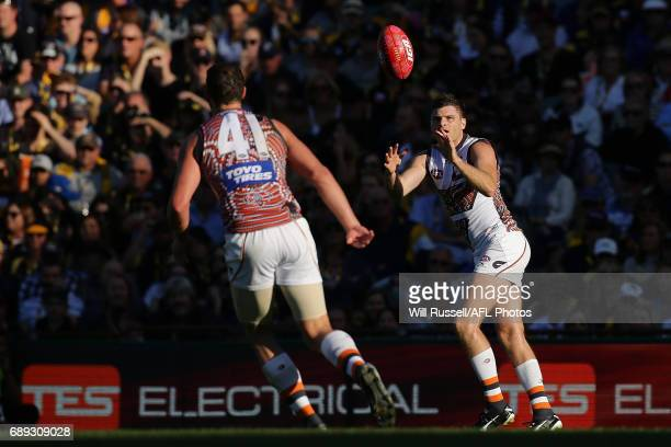 Heath Shaw of the Giants marks the ball during the round 10 AFL match between the West Coast Eagles and the Greater Western Giants at Domain Stadium...