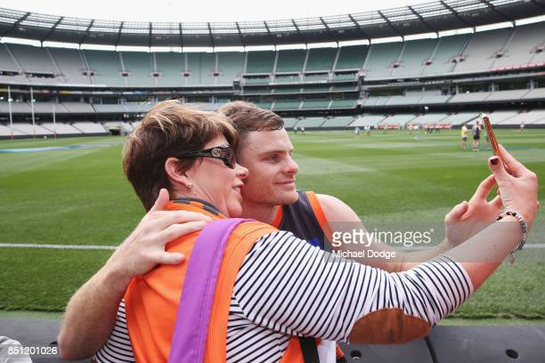 Heath Shaw of the Giants poses with a fan during the Greater Western Sydney Giants AFL training session at Melbourne Cricket Ground on September 22...