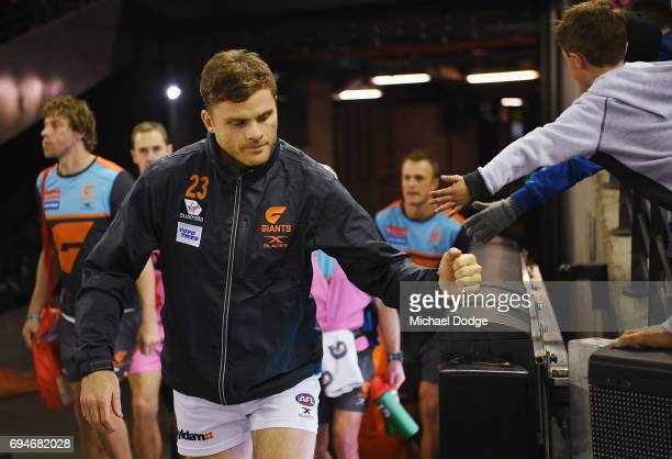 Heath Shaw of the Giants punches the fence on the way out during the round 12 AFL match between the Carlton Blues and the Greater Western Sydney...