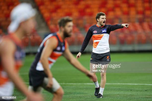 Heath Shaw of the Giants talks to team mates during a Greater Western Sydney Giants AFL training session at Spotless Stadium on August 8 2017 in...
