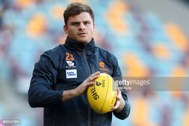 Heath Shaw of the Giants warms up before the round 14 AFL match between the Brisbane Lions and the Greater Western Sydney Giants at The Gabba on June...