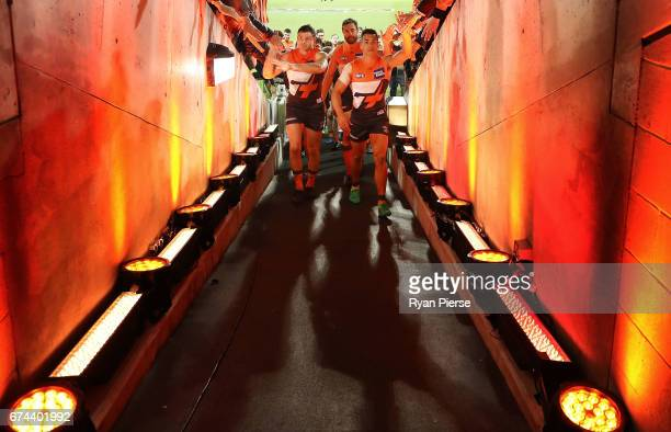 Heath Shaw Shane Mumford and Dylan Shiel of the Giants lead their team from the ground after the round six AFL match between the Greater Western...