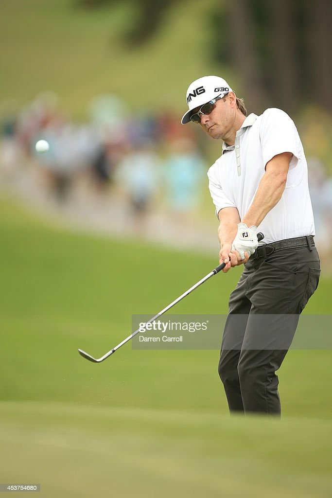 Heath Slocum chips onto the green on the 10th hole during the final round of the Wyndham Championship at Sedgefield Country Club on August 17, 2014 in Greensboro, North Carolina.
