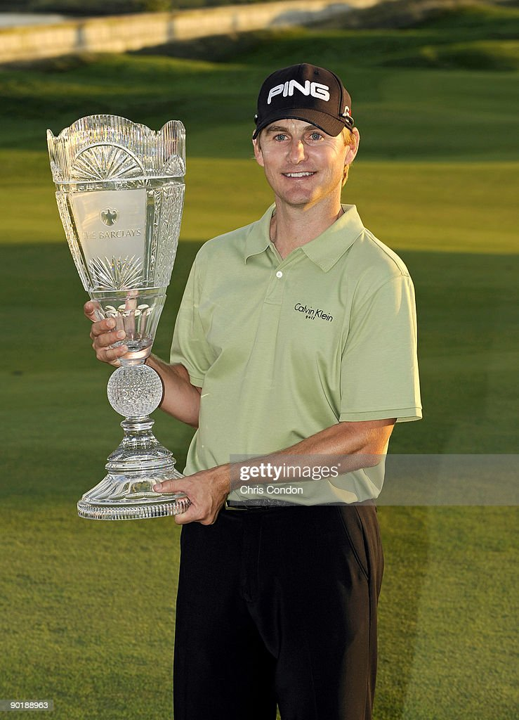 Heath Slocum poses with the tournament trophy after winning the The Barclays at Liberty National Golf Club on August 30 2009 in Jersey City New Jersey