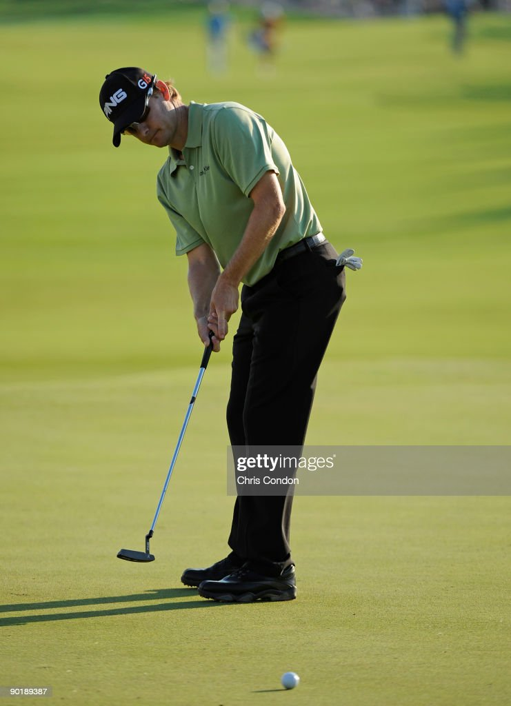 Heath Slocum putts to save par and a oneshot lead on the 18th green to clinch his victory at The Barclays at Liberty National Golf Club on August 30...