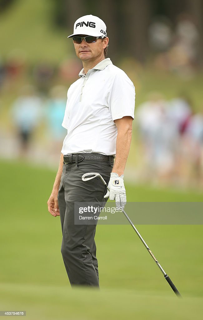 Heath Slocum reacts after chipping onto the green on the 10th hole during the final round of the Wyndham Championship at Sedgefield Country Club on August 17, 2014 in Greensboro, North Carolina.