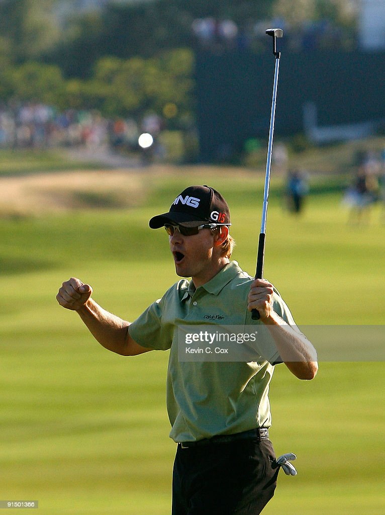 Heath Slocum reacts after sinking his par putt on the 18th green to win The Barclays on August 30 2009 at Liberty National in Jersey City New Jersey