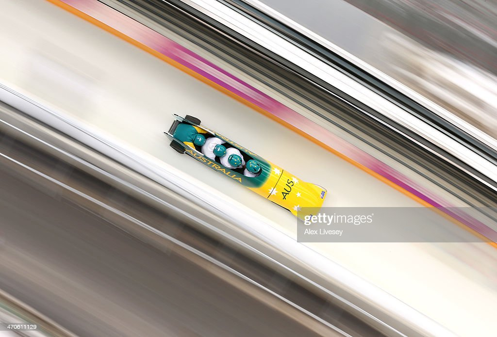 Heath Spence of Australia pilots a run during a fourman bobsleigh practice session on Day 13 of the Sochi 2014 Winter Olympics at Sliding Center...