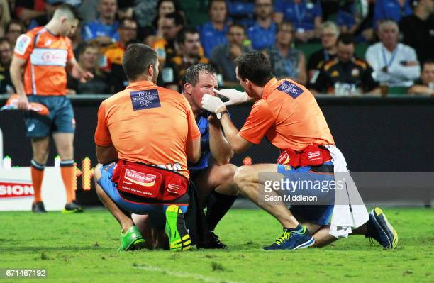 Heath Tessmann of Force receives treatment during the round nine Super Rugby match between the Force and the Chiefs at nib Stadium on April 22 2017...