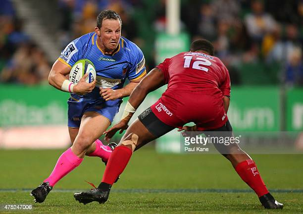 Heath Tessmann of the Force looks to avoid being tackled by Samu Kerevi of the Reds during the round 16 Super Rugby match between the Western Force...