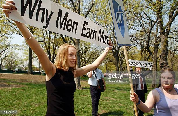 Heather Ahearn of the American Federation of Teachers tries to block the sign of Arrah Nielsen of the Independent Women's Forum during a rally which...