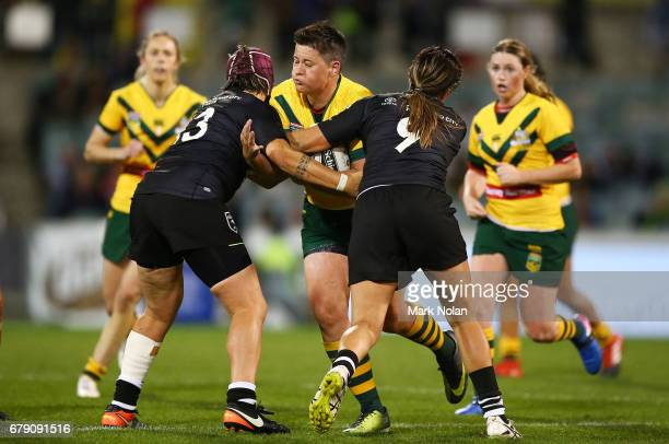 Heather Ballinger of Australia is tackled during the women's ANZAC Test match between the Australian Jillaroos and the New Zealand Kiwi Ferns at GIO...