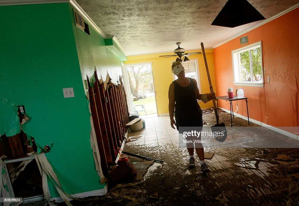 Heather Bloomfield cleans up her home that was flooded after Hurricane Ike September 15 2008 in Galveston Texas Hurricane Ike caused extensive damage...