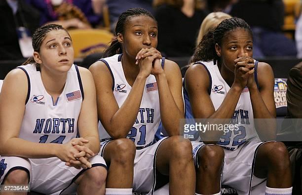 Heather Claytor Iman McFarland and Rashanda McCants of the North Carolina Tar Heels watch the clock wind down on their 8170 loss to the Maryland...