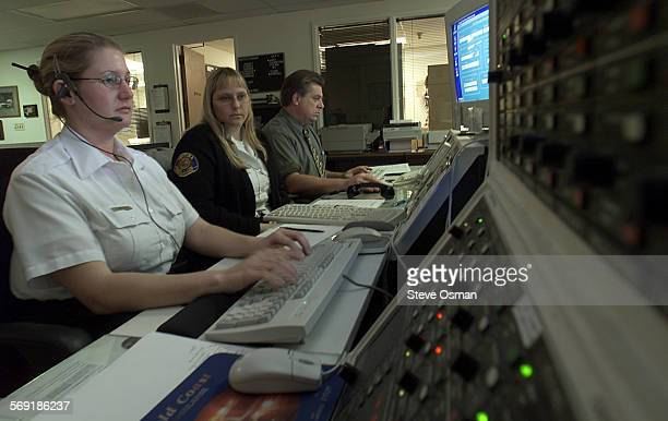 Heather Cressall left is being trained by veteran dispatcher Diana Johnson in the dispatch center for the Ventura police and fire departments Pat...